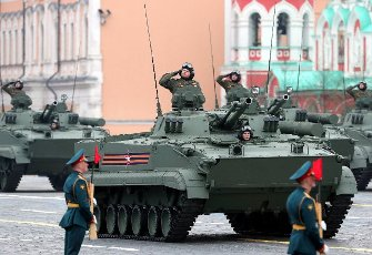 ATTENTION EDITORS! THE CAPTION IN TASS PHOTO TS0FF80F INCORRECTLY IDENTIFIED MILITARY HARDWARE. THE CORRECTED CAPTION FOLLOWS: MOSCOW, RUSSIA - MAY 9, 2021: A BMP-3 infantry fighting vehicle rolls down Moscow\'s Red Square during a Victory Day