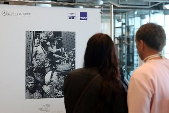 "MOSCOW REGION, RUSSIA - MAY 14, 2021: People view a photo exhibition titled ""I Will Not Forget 1945"" marking the 76th anniversary of the victory in World War II, at Domodedovo International Airport. Vladimir Gerdo\/TASS"