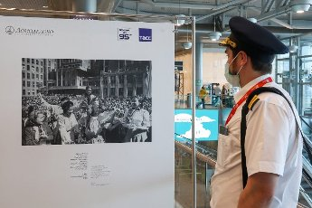 "MOSCOW REGION, RUSSIA - MAY 14, 2021: A man views a photo exhibition titled ""I Will Not Forget 1945"" marking the 76th anniversary of the victory in World War II, at Domodedovo International Airport. Vladimir Gerdo\/TASS"