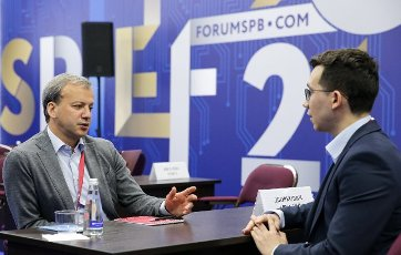 ST PETERSBURG, RUSSIA - JUNE 5, 2021: Skolkovo Foundation Chairman Arkady Dvorkovich (L) attends the International Youth Economic Forum as part of the 24th St Petersburg International Economic Forum (SPIEF 2021) at the ExpoForum Convention and