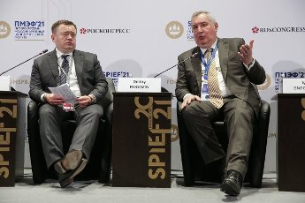 ST PETERSBURG, RUSSIA â JUNE 5, 2021: Promsvyazbank Chairman Pyotr Fradkov (L) and Russian Federal Space Agency (Roscosmos) Head Dmitry Rogozin at the 2021 St Petersburg International Economic Forum (SPIEF), at the ExpoForum Convention and