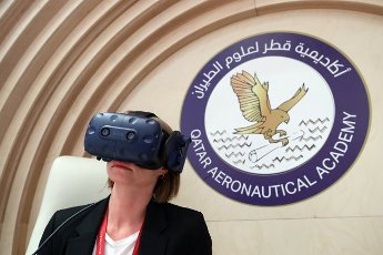 ST PETERSBURG, RUSSIA â JUNE 5, 2021: A woman tries on a virtual reality (VR) headset at Qatar Pavilion at the 2021 St Petersburg International Economic Forum (SPIEF), at the ExpoForum Convention and Exhibition Centre. Kirill Kukhmar\/TASS Host