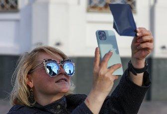 KRASNOYARSK, RUSSIA â JUNE 10, 2021: A skywatcher observes a solar eclipse. Andrei Samsonov\/TASS