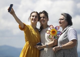 REPUBLIC OF ALTAI, RUSSIA â JUNE 15, 2021: Women take a selfie on Mount Malaya Sinyukha at the Manzherok year-round resort. Kirill Kukhmar\/TASS