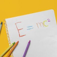 Emc2 formula on paper and colorful crayons