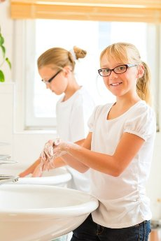 Children - Sisters or daughter with friends are washing hands at the washbasin