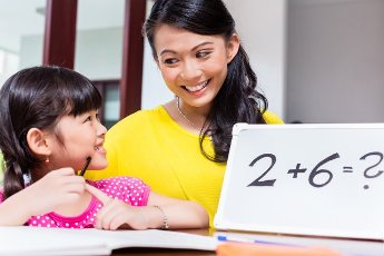 Chinese mother teaching mathematics to child
