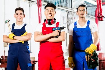 Team of Workers with tools in Asian industrial factory