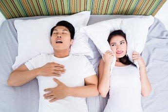 Chinese man snoring keeping his unhappy wife awake