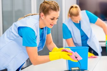 Commercial cleaning crew ladies working as team in office
