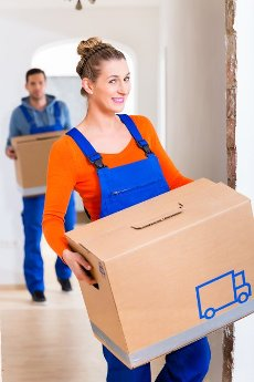 Woman and man moving in new home with boxes