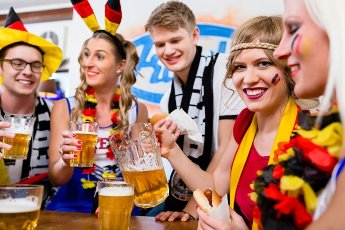 Football fans watching a game of the German national team drinking beer