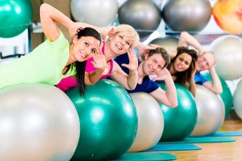 Sport and fitness in gym - diverse group of people training, diversity group of old, young, black and white people