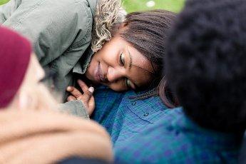 Close-up of girlfriend sleeping on her boyfriend\'s chest