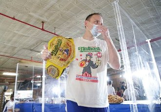 The #1-ranked eater in the world Joey Chestnut walks off of the stage after winning the 104th Nathan\'s Famous Fourth of July International Hot Dog Eating Contest with a record total of 75 hot dogs and buns on July 4, 2020 in New York City. The Nathan\'s Famous Fourth of July International Hot Dog Eating Contest has occurred each July 4th in Coney Island since 1916. This years competition was held at an undisclosed location in an attempt to control crowds due to the Coronavirus pandemic. Photo by John Angelillo