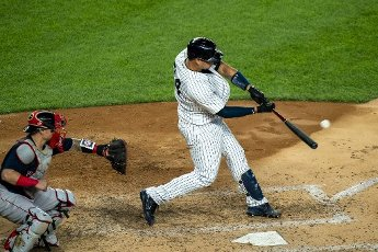 New York Yankees Gary Sanchez hits a two run home run scoring Mike Tauchman in the fifth inning against the Boston Red Sox at Yankee Stadium on Friday, August 14, 2020 in New York City. Photo by Corey Sipkin