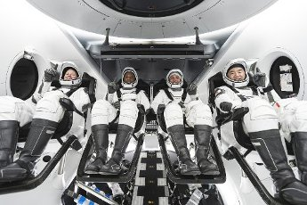NASA\'s SpaceX Crew-1 crew members are pictured seated in the company\'s Crew Dragon spacecraft during crew equipment interface training. From left to right are NASA astronauts Shannon Walker, mission specialist; Victor Glover, pilot; and Mike Hopkins, Crew Dragon commander; and JAXA astronaut Soichi Noguchi, mission specialist. NASA and SpaceX are targeting no earlier than Oct. 23 for the first operational flight with astronauts of the Crew Dragon spacecraft and Falcon 9 rocket to the International Space Station as a part of the agency\'s Commercial Crew Program. NASA\'s SpaceX Crew-1 mission will be the first of regular rotational missions to the space station following completion of NASA certification. Photo credit