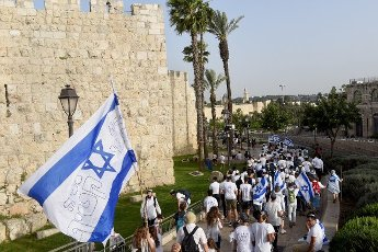 Israelis take part in the annual Jerusalem Day march, outside the Old City of Jerusalem, marking the reunification of Jerusalem during the Six Day War on Monday, May 10, 2021. The march was cut short when Hamas fired rockets towards Jerusalem. Photo by Debbie Hill