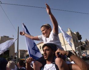 Israelis take part in the annual Jerusalem Day march marking the reunification of Jerusalem during the Six Day War on Monday, May 10, 2021. The march was cut short when Hamas fired rockets towards Jerusalem. Photo by Debbie Hill