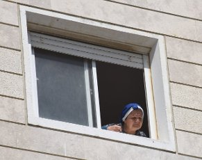 An Israeli woman looks at an apartment building hit by a rocket fired from the Gaza Strip in Ashkelon in southern Israel, on Tuesday, May 11, 2021. Photo by Debbie Hill