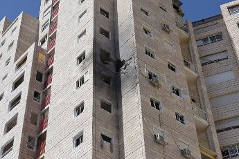 A view of an apartment building hit by a rocket fired from the Gaza Strip in Ashkelon in southern Israel, on Tuesday, May 11, 2021. Photo by Debbie Hill
