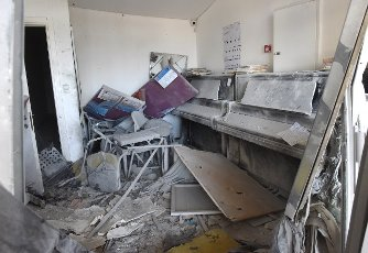 Pianos are covered with debris in a building hit by a rocket fired from the Gaza Strip in Ashkelon in southern Israel, on Tuesday, May 11, 2021. Photo by Debbie Hill