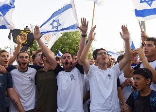 Israelis chant national slogans during the annual Jerusalem Day march, outside the Old City of Jerusalem, marking the reunification of Jerusalem during the Six Day War on Monday, May 10, 2021. The march was cut short when Hamas fired rockets towards Jerusalem. Photo by Debbie Hill