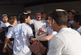 Israelis chant while sheltering after an air raid siren sounded during the annual Jerusalem Day march marking the reunification of Jerusalem during the Six Day War on Monday, May 10, 2021, outside Jerusalems Old City. The march was cut short when Hamas fired rockets towards Jerusalem. Photo by Debbie Hill