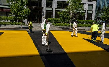 City Workers re-paint Black Lives Matter Plaza near the White House Washington, DC on Thursday May 13 2021. Workers had to dig up the ground at Black Lives Matter plaza for upgraded underground energy grid, was repaved earlier this week. Photo by Tasos Katopodis