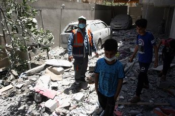 Palestinians inspect their destroyed houses following overnight Israeli airstrikes in town of Rafah, suothern Gaza Strip, on Friday, May 14, 2021. Israel pounded Gaza and deployed extra troops to the border as Palestinians fired barrages of rockets back, with the death toll in the enclave on the fourth day of conflict climbing to over 100. photo by Ismael Mohamad