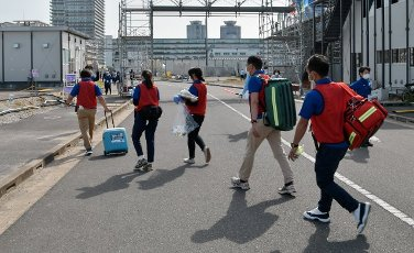 """Medical staffs are seen walk during the Tokyo 2020 Olympics skateboarding test event """"READY STEADY TOKYO"""" at Ariake Urban Sports Park in Tokyo, Japan on Friday, May 14, 2021. Photo by Keizo Mori"""