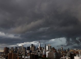 Storm clouds pass over One World Trade Center and the Manhattan skyline before a thunder storm on Tuesday, June 8, 2021 in New York City. Photo by John Angelillo