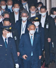 Japan\'s Prime Minister Yoshihide Suga walks after the party leaders\' debate session at the National Diet in Tokyo, Japan on Wednesday, June 9, 2021. Photo by Keizo Mori