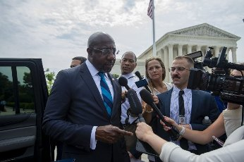 Sen. Raphael Warnock, D-GA, speaks with reporters after a rally supporting For The People, a bill intended to expand voting rights, outside the Supreme Court in Washington, D.C., on Wednesday, June 9, 2021. Photo by Bonnie Cash