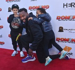 """Director and cast member Baron Davis and his sons Luke (R) and Kingman (L) attend the premiere of the motion picture comedy """"Domino: Battle of the Bones"""" in Los Angeles on Wednesday, June 9, 2021. """"Domino: Battle of the Bones"""" is a feel-good comedy about an elderly black man who teams up with his awkward, white step-grandson to defeat his rival in a domino tournament. Photo by Jim Ruymen"""