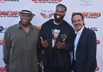 """Cast members Lou Beatty Jr., Baron Davis and David Arquette attend the premiere of the motion picture comedy """"Domino: Battle of the Bones"""" in Los Angeles on Wednesday, June 9, 2021. """"Domino: Battle of the Bones"""" is a feel-good comedy about an elderly black man who teams up with his awkward, white step-grandson to defeat his rival in a domino tournament. Photo by Jim Ruymen"""