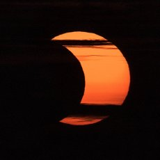 """A partial solar eclipse is seen from Arlington, Virginia, Thursday, June 10, 2021. The annular or """"ring of fire"""" solar eclipse is only visible to some people in Greenland, Northern Russia, and Canada. Photo Credit: (NASA\/Bill Ingalls"""