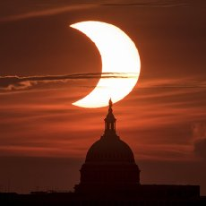 """A partial solar eclipse is seen from Arlington, Virginia, Thursday, June 10, 2021. The annular or """"ring of fire"""" solar eclipse is only visible to some people in Greenland, Northern Russia, and Canada. Photo by Bill Ingalls\/NASA"""