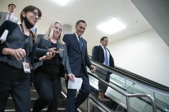 Senator Mitt Romney, R-UT, talks to reporters in the Senate subway at the U.S. Capitol in Washington DC, on Thursday, June 10, 2021. Senators voted to confirm Zahid N. Quraishi to be US District Judge for the District of New Jersey. Photo by Sarah Silbiger