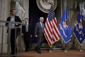 U.S. Attorney General Merrick Garland walks on stage before delivering remarks on voting rights at the U.S. Department of Justice in Washington, DC on Friday, June 11, 2021. Pool photo by Tom Brenner