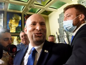 Israeli Prime Minister Naftali Bennett smiles after the traditional group photo of the new government with President Reuven Rivlin at his residence in Jerusalem, on Monday, June 14, 2021. Photo by Debbie Hill