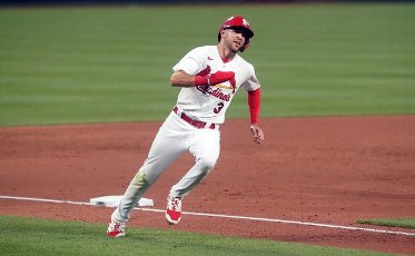 St. Louis Cardinals Dylan Carlson rounds third base, trying to score from first base on a double by Tyler O\'Neill in the third inning against the Miami Marlins at Busch Stadium in St. Louis on Monday, June 14, 2021. Carlson was out at home plate. Photo by Bill Greenblatt