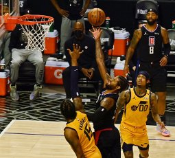 Los Angeles Clippers guard Paul George (13 scores on Utah Jazz forward Derrick Favors (15) during the second half of Game 4 of their second-round, best-of-seven Western Conference playoff series matchup at Staples Center in Los Angeles on Monday, June 14, 2021. The Clippers defeated the Jazz 118-104 to even the series 2-2. Photo by Jim Ruymen