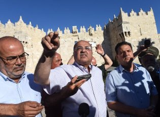 Ahmad Tibi of the Arab Joint List Party speaks before the controversial Flag Parade outside the Damascus Gate in Jerusalem\'s Old City on Tuesday, June 15, 2021. Photo by Debbie Hill