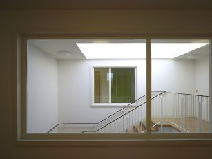 View through to stairway with skylight. Watford Music Centre, Watford, United Kingdom. Architect: Tim Ronalds Architects, 2008
