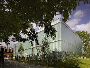 Corner elevation across sloping road. Watford Music Centre, Watford, United Kingdom. Architect: Tim Ronalds Architects, 2008