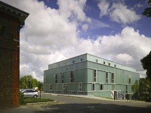 Corner elevation across main campus road. Watford Music Centre, Watford, United Kingdom. Architect: Tim Ronalds Architects, 2008