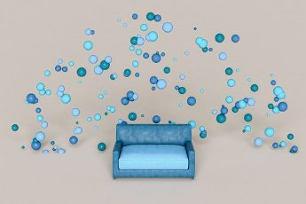 Blue sofa and spheres against white background