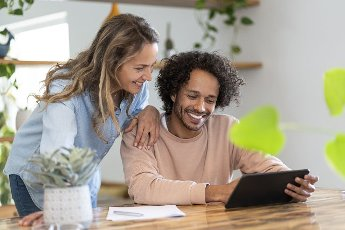 Businessman and woman looking at digital tablet together