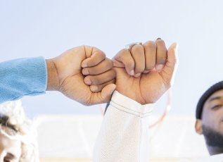 Female and male friend giving fist bump